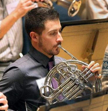 Casey Golomski, an anthropologist from Boston, played the French horn.
